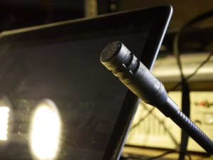 One of the microphones in the work stations available on the Hill's mobile production bus.