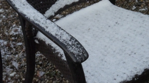 Snow on chairs.